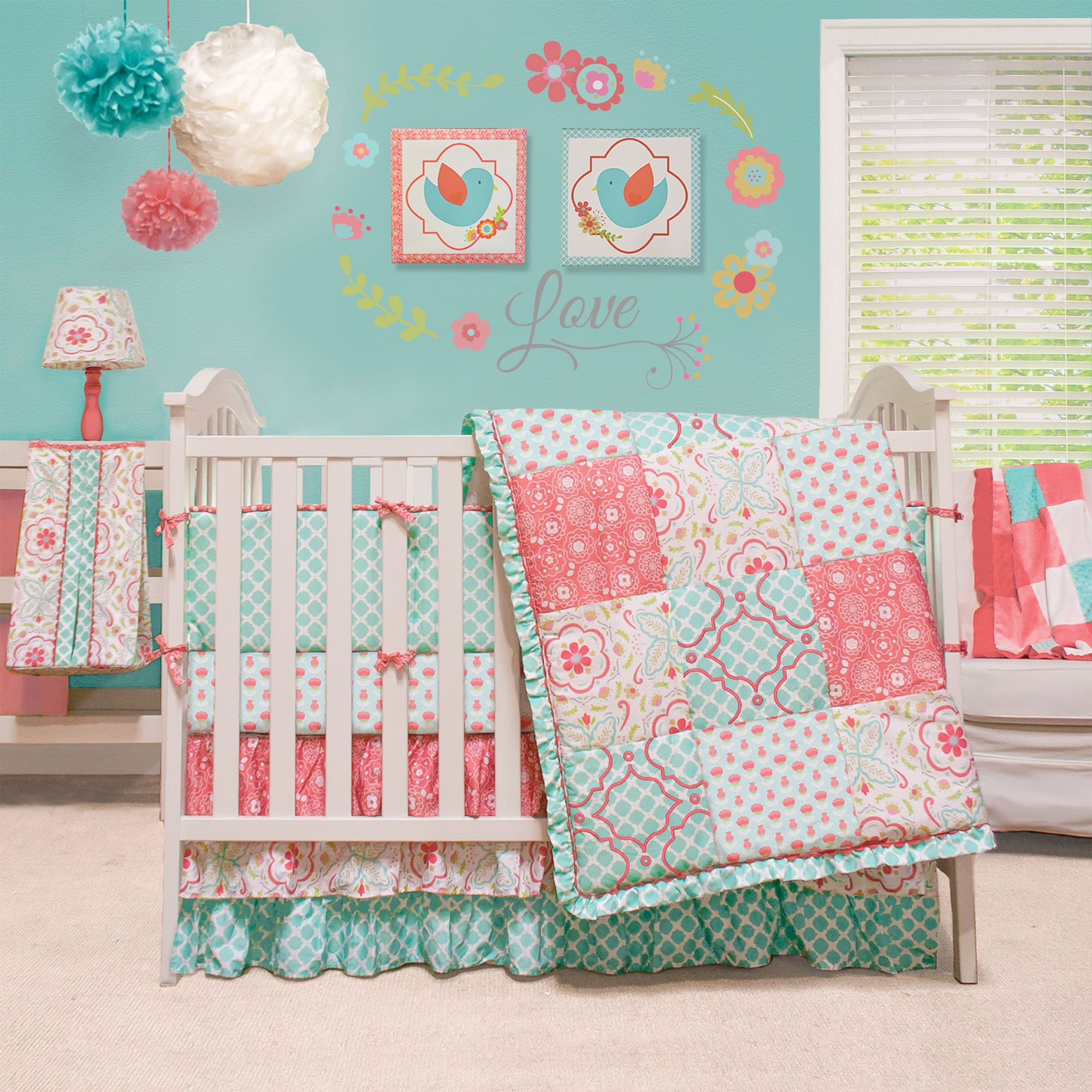 The Peanut Shell Mila 4 piece crib bedding set features a traditional patchwork design with a combination of contemporary floral and graphic prints in a vivid colorway of aqua, white, green and coral.