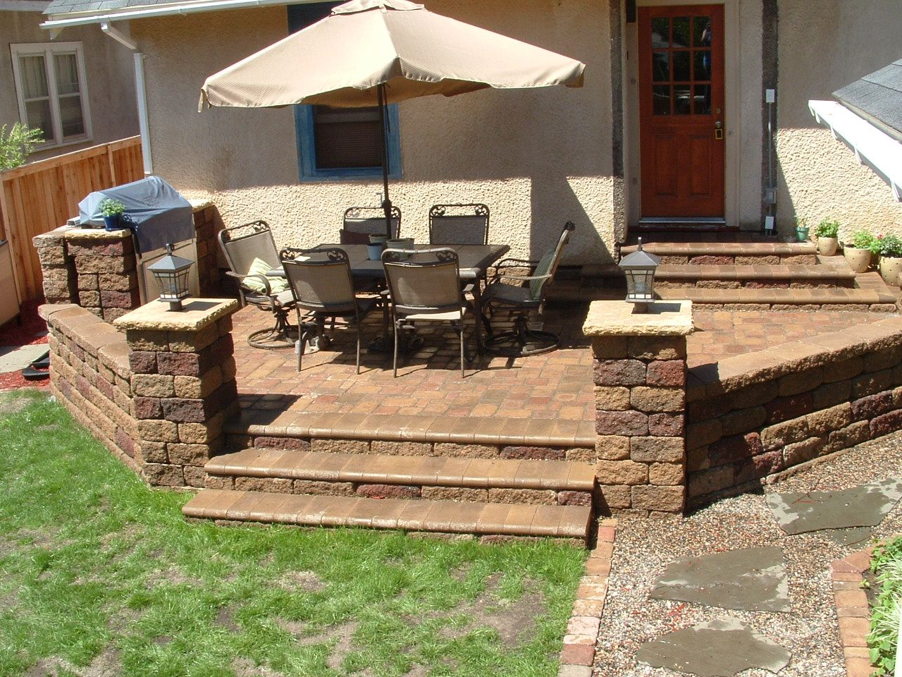 Raised patio ideas - After You D Hardly Recognize The Old Yard Now With A Stylish Raised Patio And Outdoor Kitchen Built On Versa Lok And Covered With Willow Creek Pavers