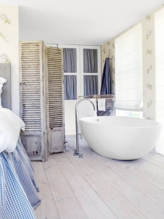 Scandinavian Style ~ A Shutter Divider, Soft White Blinds, Fabric instead of Glass Panels for the Door Panels and White Wood Floor. Rustic balanced with a modern bath tub.