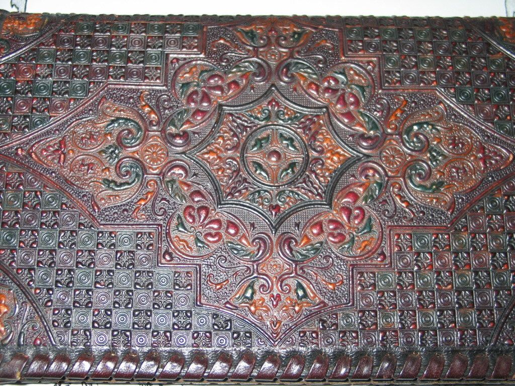 Clutch Handbag Leather Hand Tooled and Colored Amazing Unique Detailing And Features by Fairlyunique on Etsy https://www.etsy.com/listing/120385571/clutch-handbag-leather-hand-tooled-and