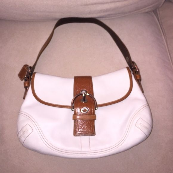 Coach Soho Bag Good Used Condition. A few marks on the back of the purse. Slight wear on the bottom. A small spot with yellowing on the bottom of the purse. Pics posted. Coach Bags Shoulder Bags