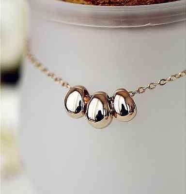 18k gold triple bean necklace