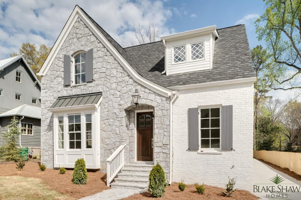 Stone and painted brick tudor blake shaw homes atlanta White painted brick exterior