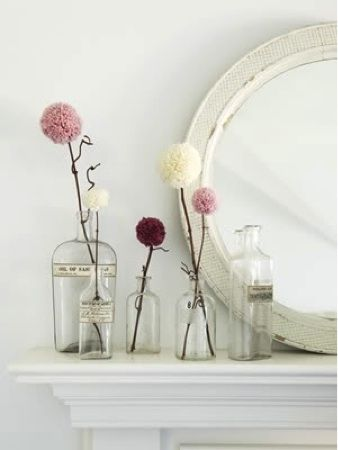 cute idea: apothecary bottle with pom pom flowers for decoration