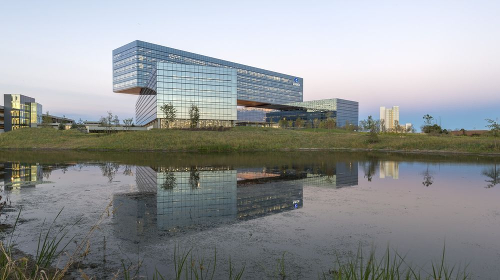 """Swiss-based Zurich Insurance Group has officially welcomed its roughly 3,000 employees to its newly opened North American headquarters located in suburban Schaumburg. Comprised of three stacked and offset """"bars,"""" a 783,800-square-foot, henge-like office building anchors the firm's 40-acre campus. Designed by Chicago-based architect Goettsch Partners, this unique layout offers better views, sunlight, and flexible programming options compared to traditional center-core offices. 9/2016"""