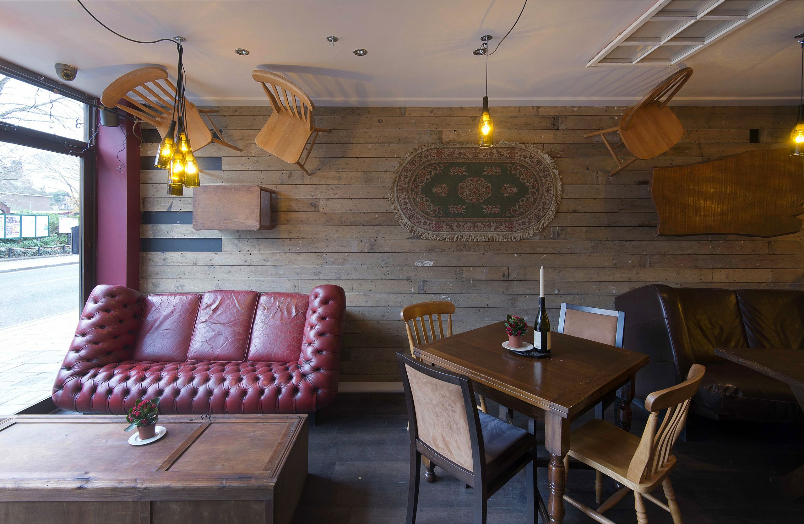 Wine bar Cellar Magneval in Fleet, Hampshire, UK. Featuring off the wall furniture including leather sofa and reclaimed wooden furniture