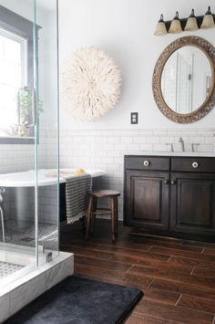Hardwood Floor In Bathroom luxurious bathroom with a modern central bath tub and hardwood floor Dark Wood Look Tile Floor White Subway Tile Wall