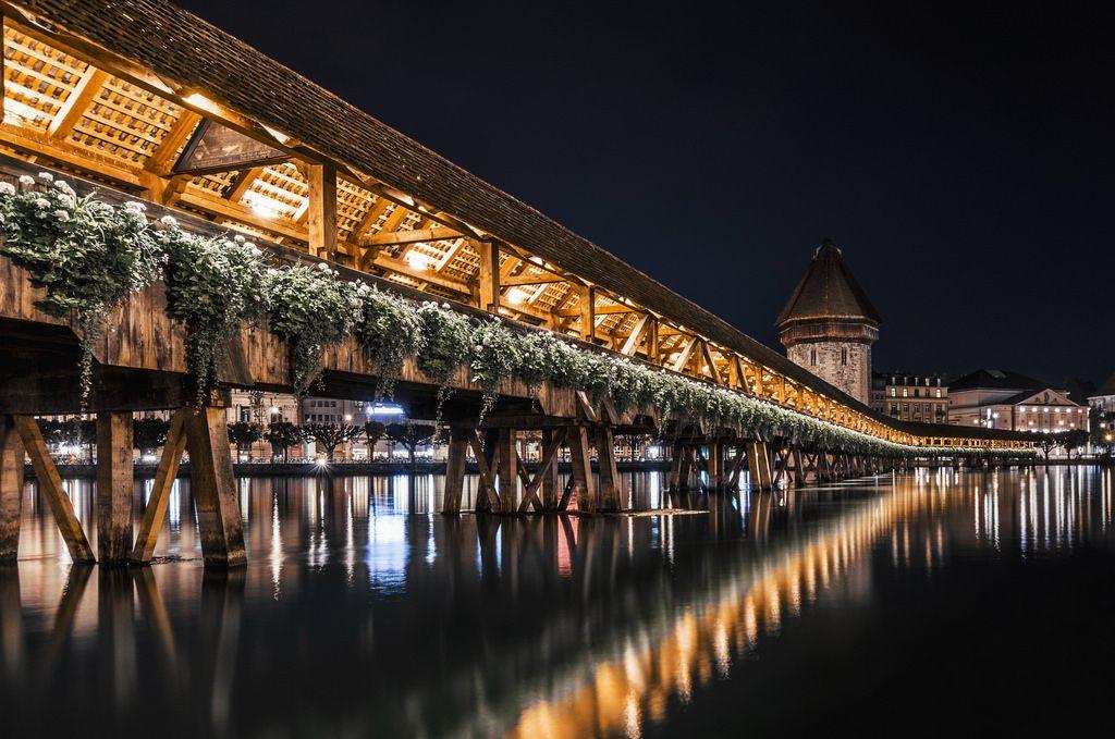 Luzern Switzerlandu0027s Kapellbrücke (Chapel Bridge) The Oldest Wooden Covered  Bridge In Europe. While