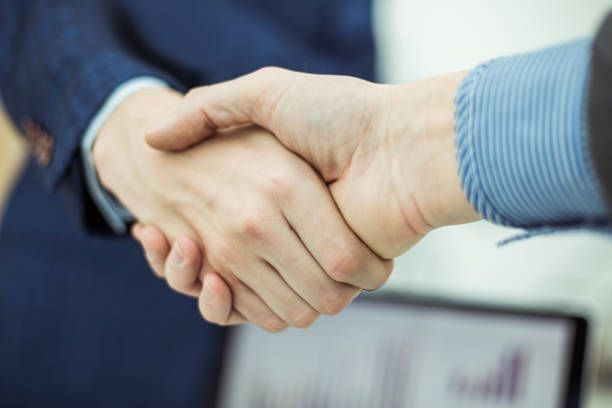 concept of partnership in business a handshake of business partners
