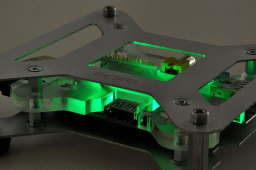 Raspberry Pi case with green LED.