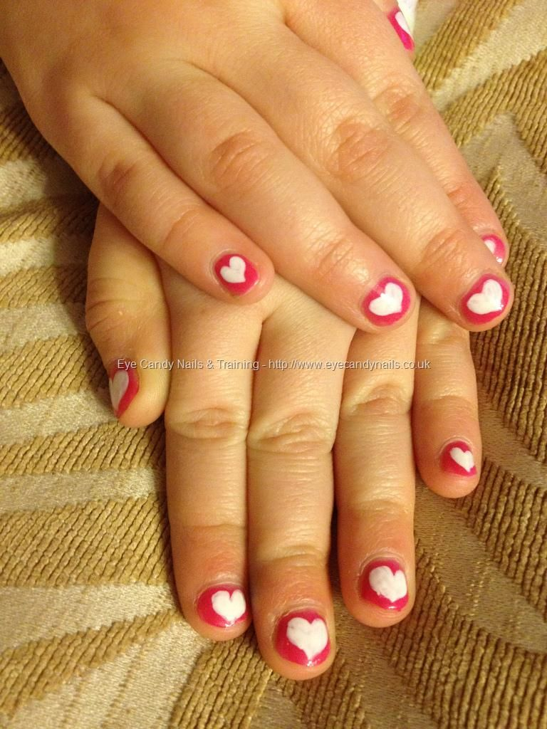 Pink polish with white freehand love heart nail art on Little Sophie ...
