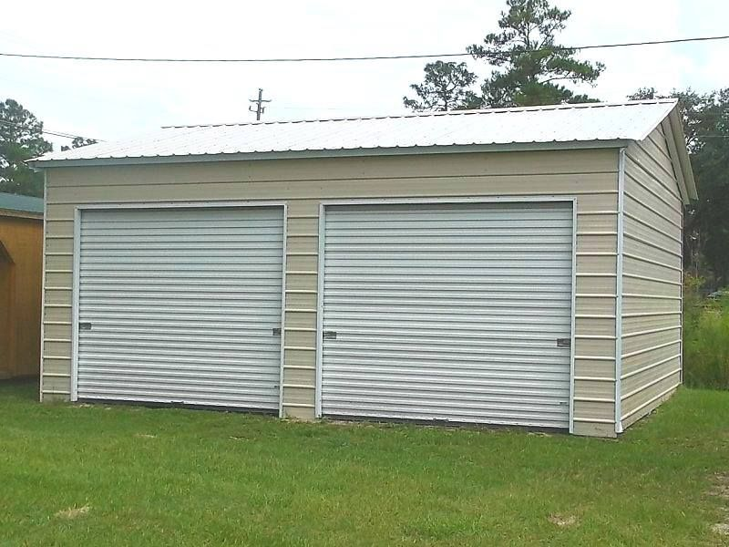 This 20'W x 21'L x 9'H vertical roof metal garage includes