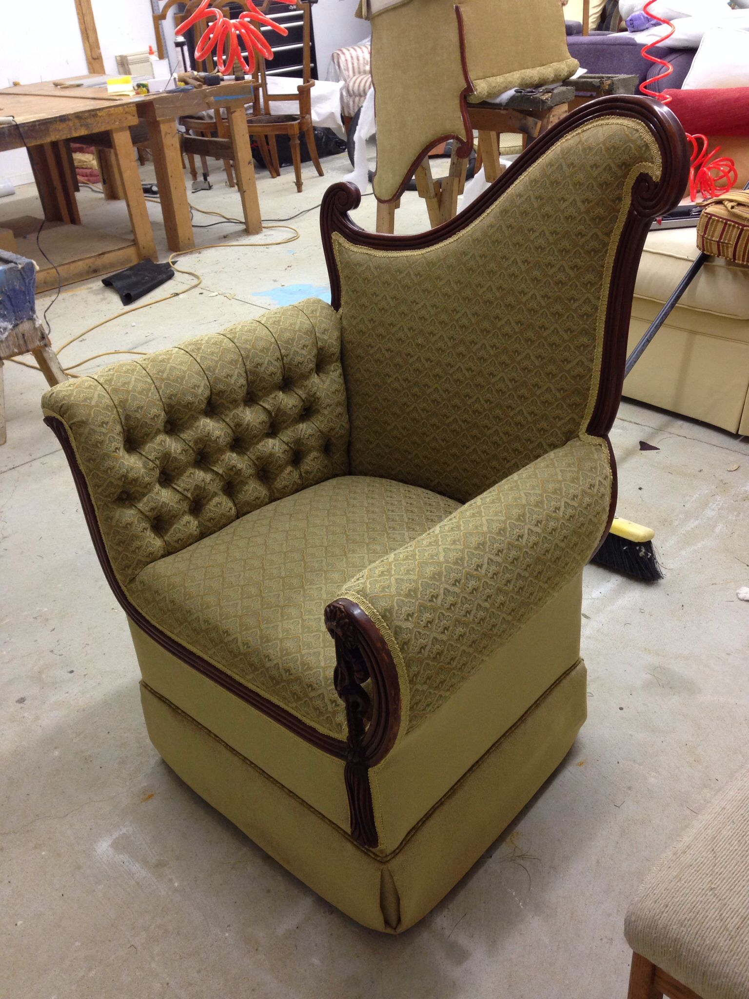 Antique chair with tufting on inside arm work done by del
