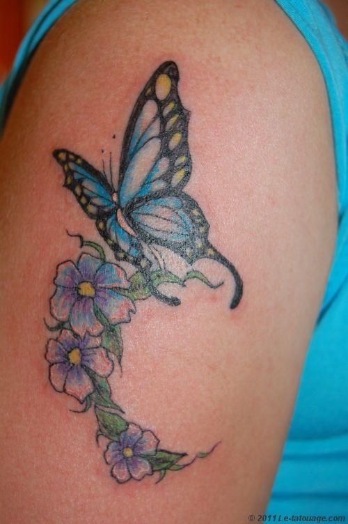 tatouage fleur tatouage papillons et fleurs photos et. Black Bedroom Furniture Sets. Home Design Ideas