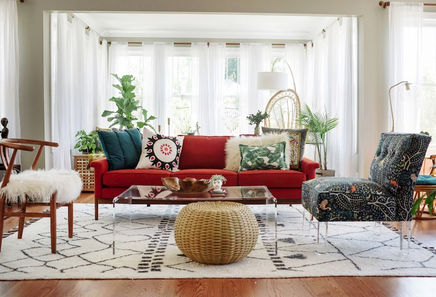 Modern, eclectic living room with red couch, plants and