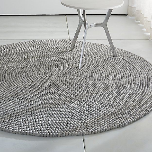 5 1400 Round Grey Rug Composed Of Small Felt This Textural Contemporary Features The Artistry A Nepali Textile Tradition