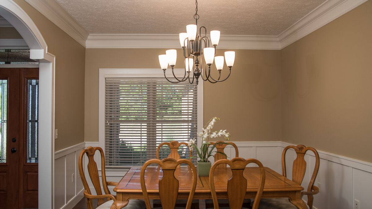Berkshire Dining Room - Barrington model dining room feature custom arches and wainscotting