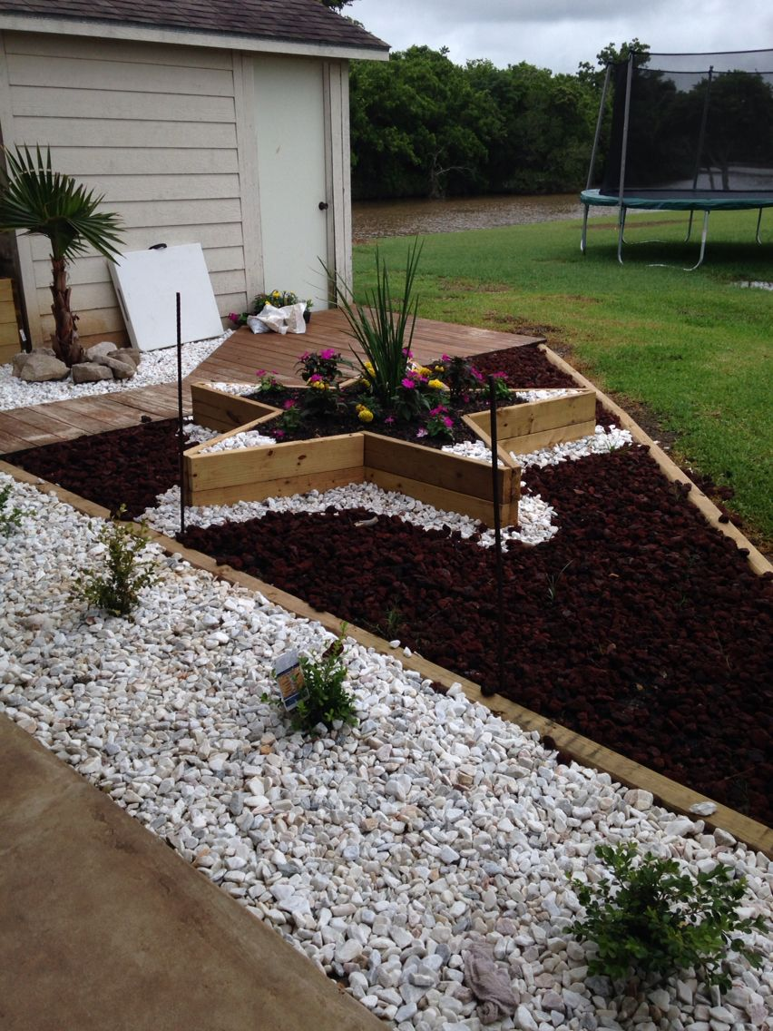 Star Flower Bed Surrounded By Red Lava Rock And High Lighted With White Has Been A Conversational Piece All Who Visit