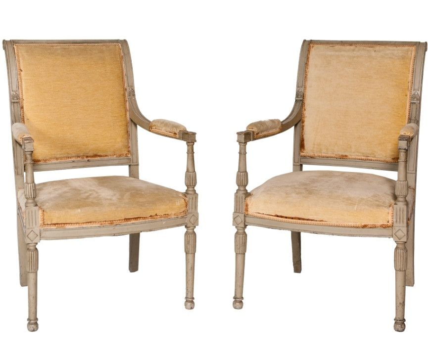 Pair of turn of the century French armchairs with Louis XVI styled frames in their original fabric and paint.