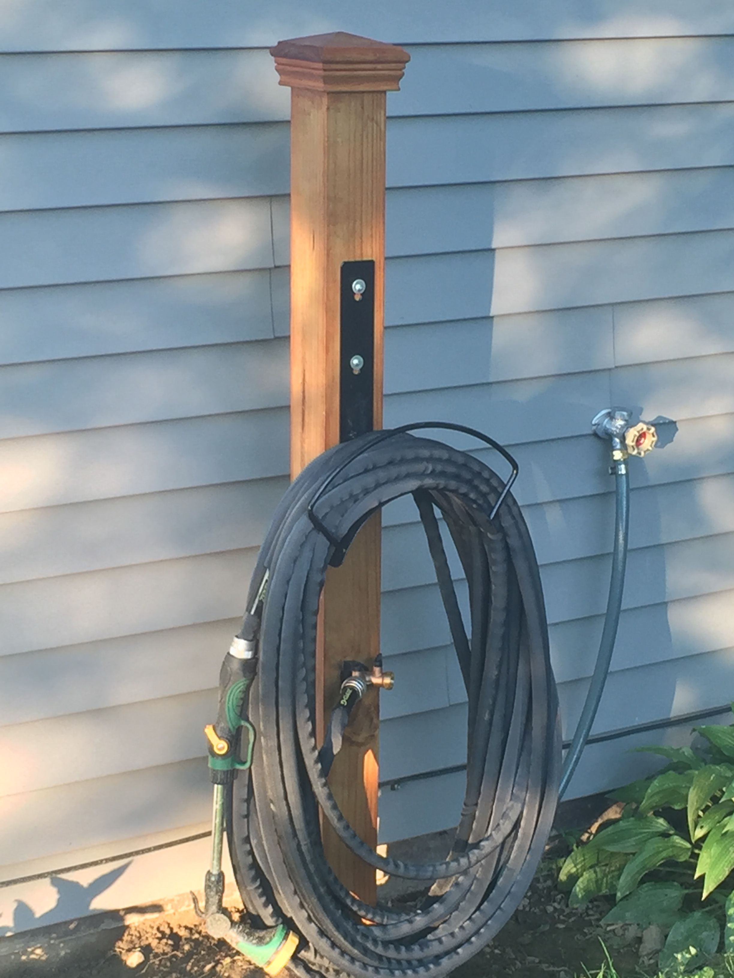 Diy garden hose holder.  Garden hose storage, Garden hose holder