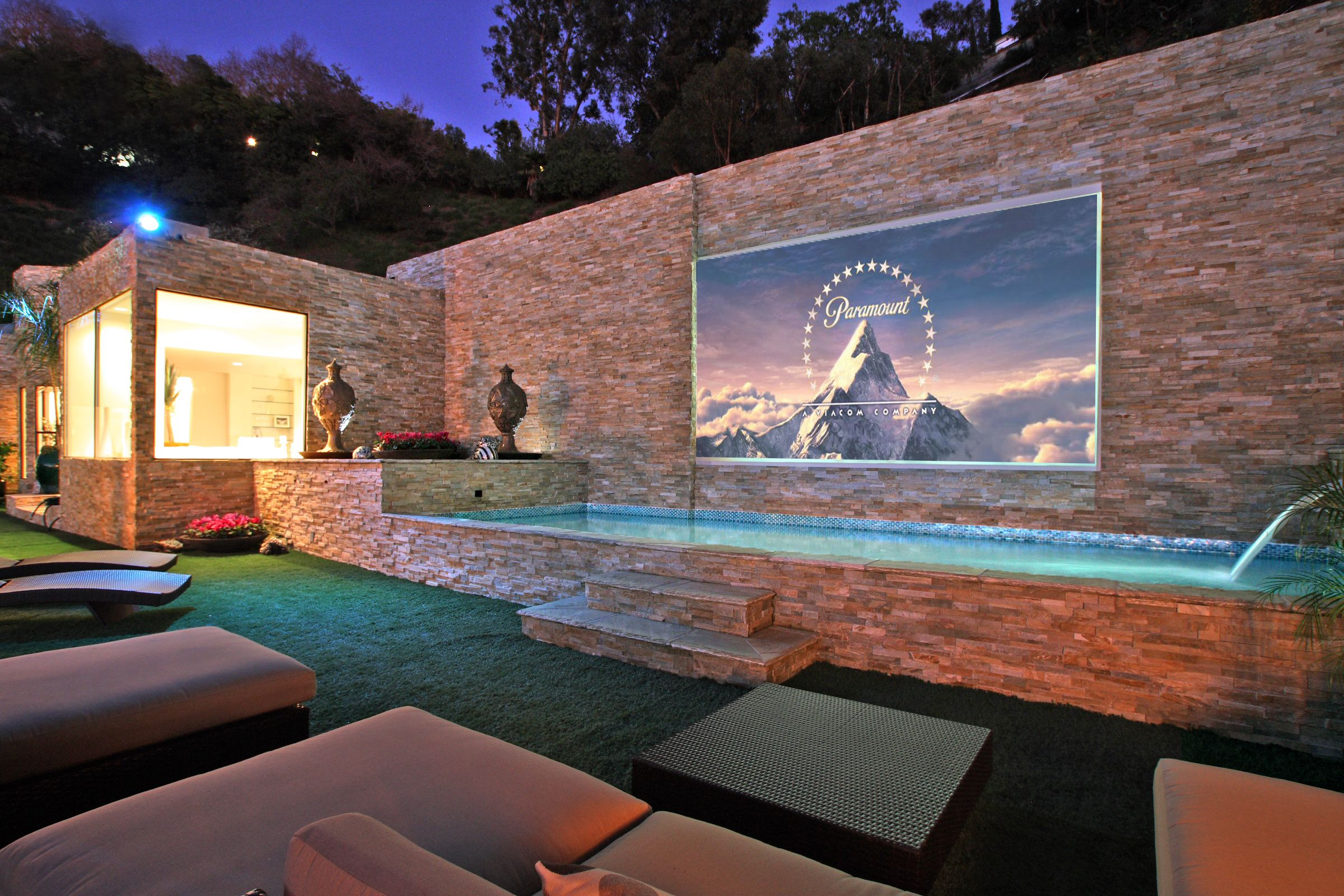 a built in theater by the pool oh you know swimming and watching