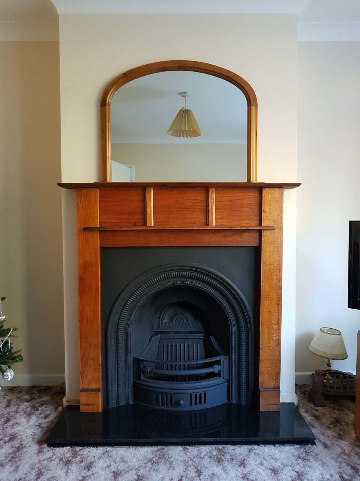 installation of collingham black cast iron on a black granite hearth