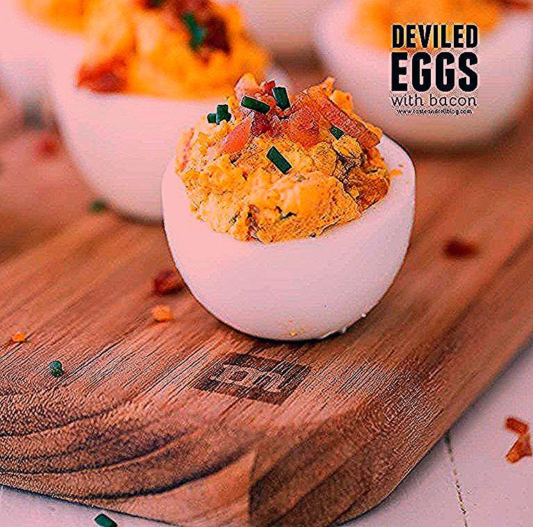 What could be better than bacon and eggs? These Deviled Eggs with Bacon add salty bacon to a traditional deviled egg recipe for an appetizer that will disappear off the plate. #deviledeggs