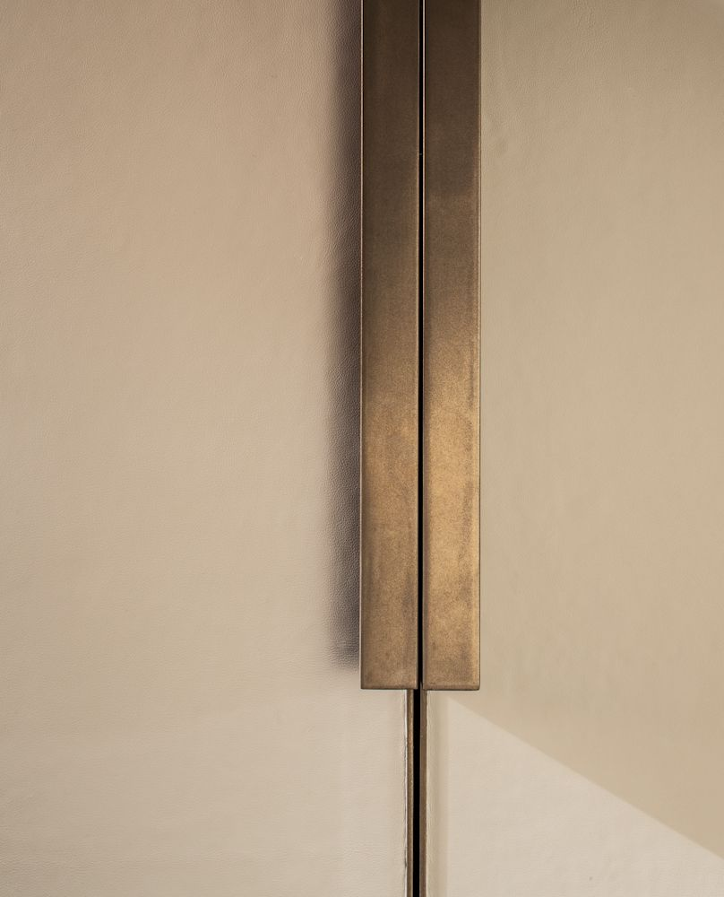 Echlin leather wardrobe door with bronze handle and inlay | my ...