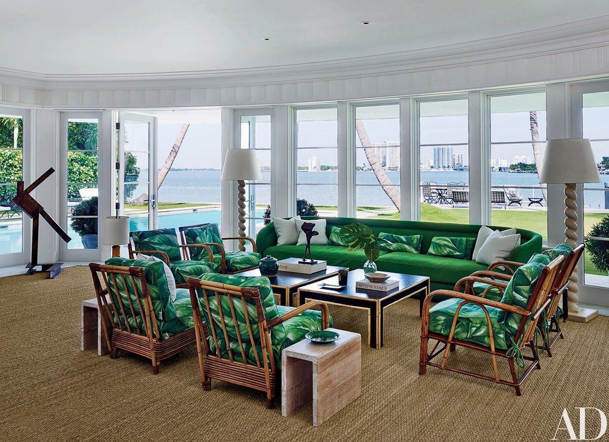 The sunroom's Austin Harrelsondesigned sofa, clad in a Clarence House  fabric, is