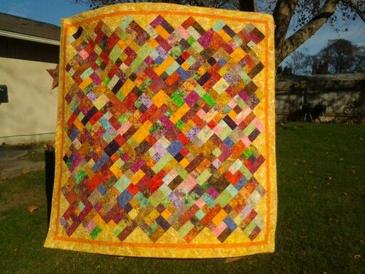 Tropical Twist, I made this for Melissa, it was quilted by Janie Levanger.