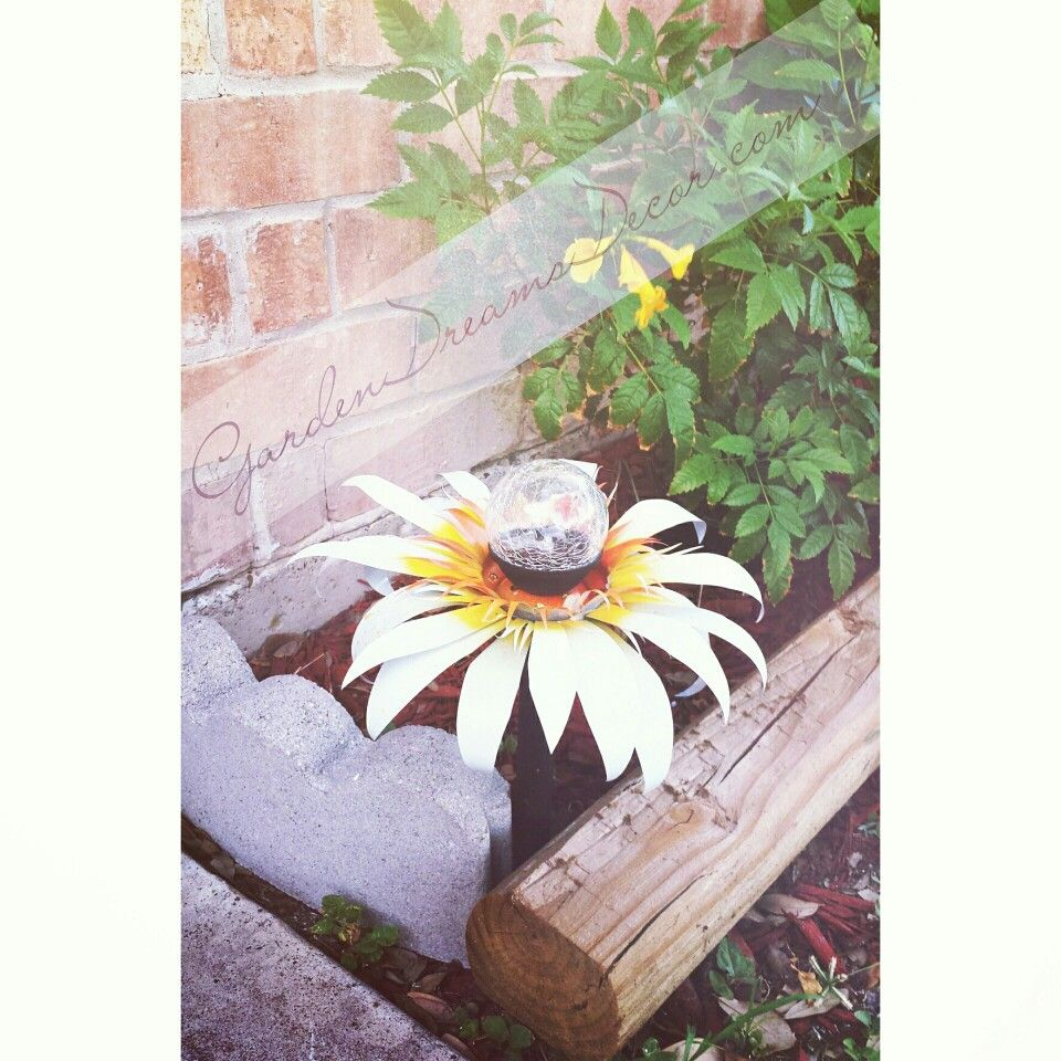 Daisy Solar Light Flower   These flowers are perfect for the front yard and garden! They can be customized any way you like and the color changing solar light adds tons of extra flare! Only $15 at gardendreamsdecor.com