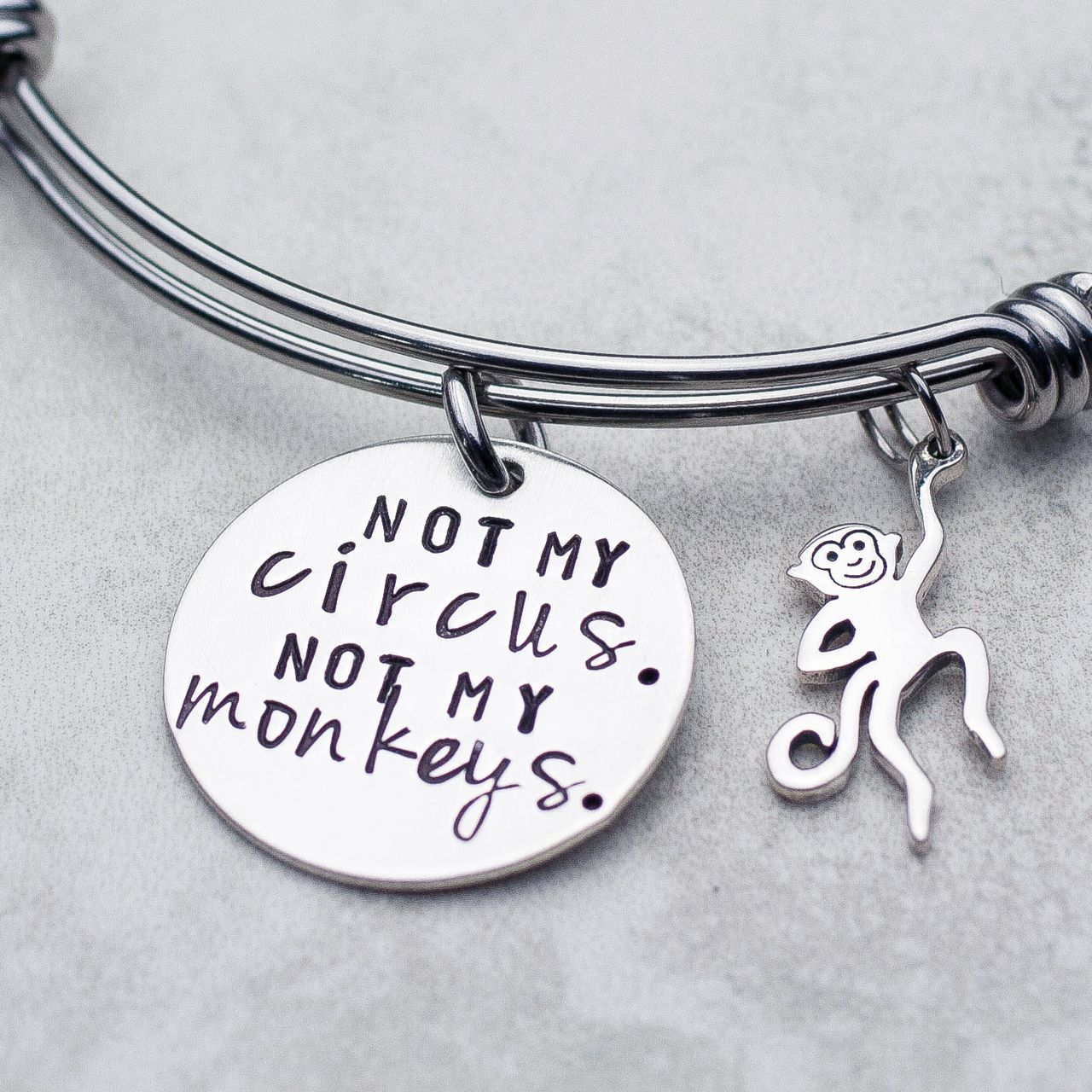 Shop for fun handmade bangle bracelets like this not my circus not my monkeys bracelet at jessie girl jewelry