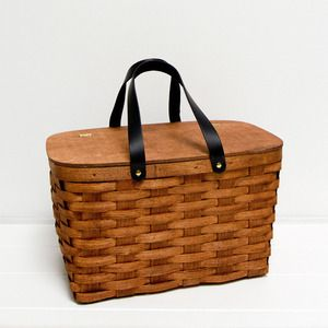 Image of picnic basket | green & white lining | a sunny afternoon.