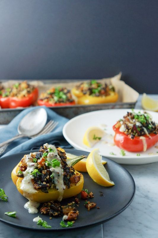 Quinoa and roasted vegetable stuffed yellow and red peppers recipe. A healthy vegetarian recipe