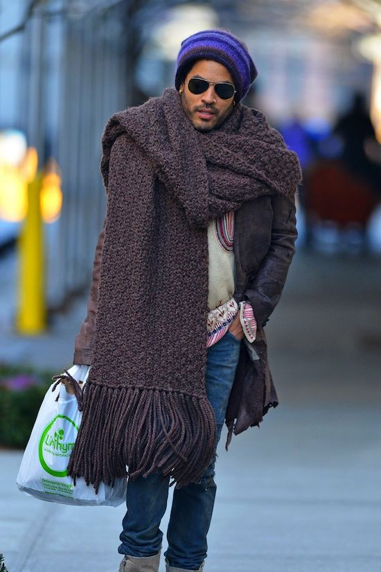 3388f5fc669 Lenny Kravitz fights the winter chill with a giant scarf and knit hat