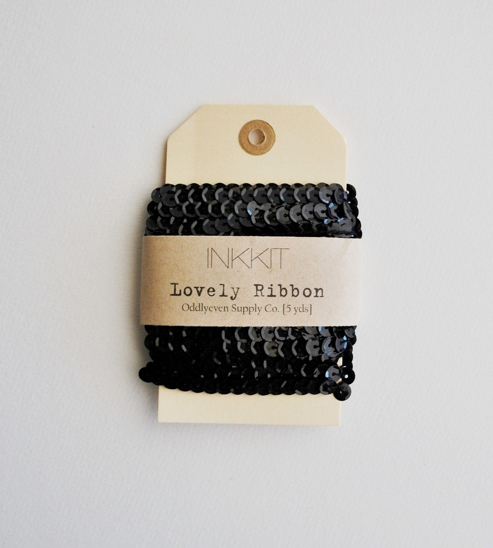 black sequin ribbon (5 yards). $3.00, via Etsy.