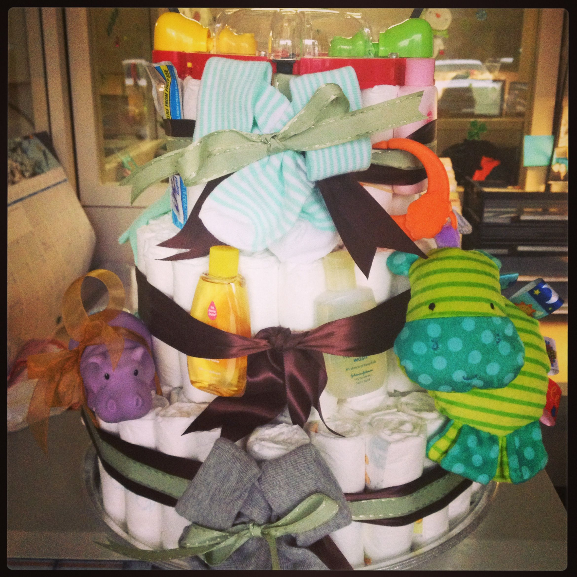 My custom hippo themed diaper cake made for a coworker... Facebook page: Custom Diaper Cakes by TLC