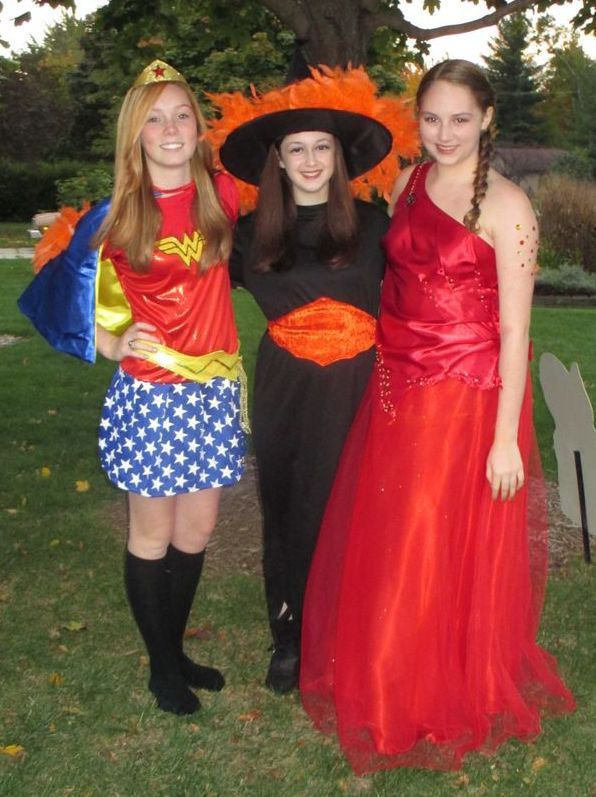 Group of teen girls dressed up for Halloween.  See more fun Halloween costumes and party ideas at one-stop-party-ideas.com