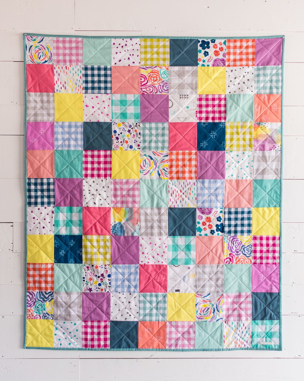 I am forever making things at the last minute, and this baby quilt for a friend was no exception! I cut the squares on Thursday night, sewed it together, quilted, and sewed the binding to the front on Friday night, and stitched the binding down by hand on Saturday before the shower. I even had five spare minutes to photograph it before I had to head to the shower on Saturday! I love a good challenge :) Since my friends know the baby is a girl, it was the perfect excuse to sew with my ...