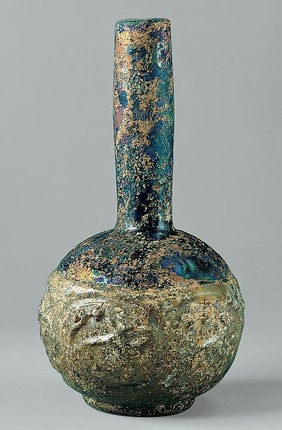 Bottle with Molded Designs of Animals Object Name: Bottle Date: 9th–10th century Geography: Iraq or Syria Culture: Islamic Medium: Glass, greenish yellow; blown in two parts, impressed with tongs Dimensions: H. 7 1/2 in. (19.1 cm) Diam. 3 3/4 in. (9.5 cm) Classification: Glass Credit Line: Rogers Fund, 1908