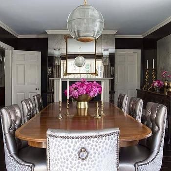 Black And Gray Dining Room With Antique Mirror Wall