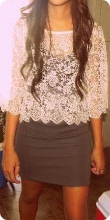 Lace top over a dress.
