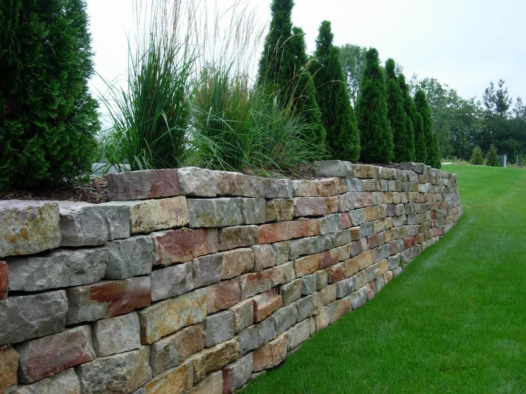Stacked retaining wall cottage block garden care and for Rock wall garden