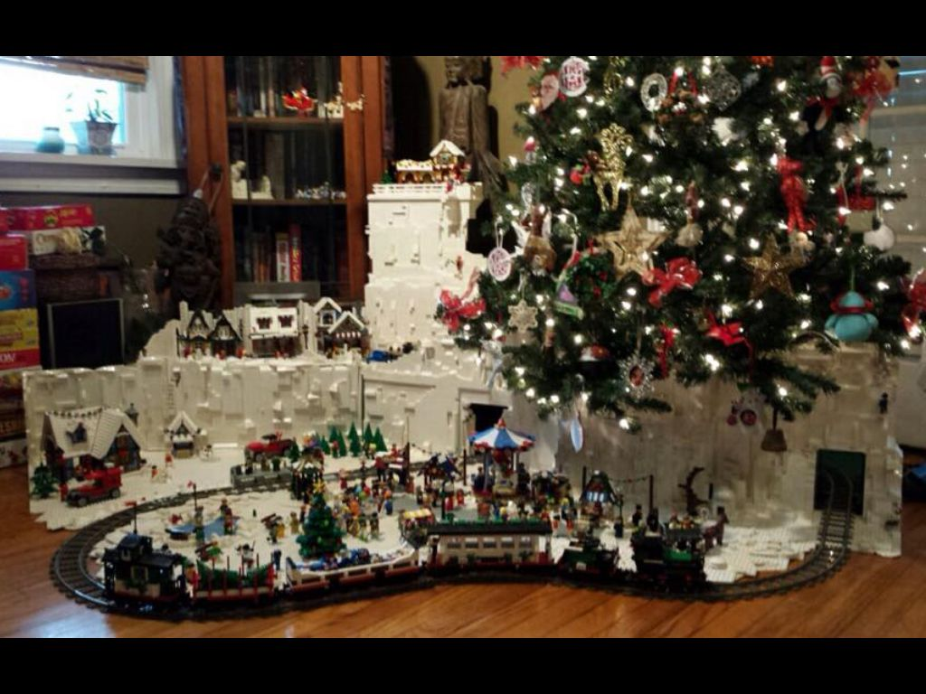 awesome lego christmas tree village a different approach to the classic train around the tree includes a winter carnival cottage tree farm village