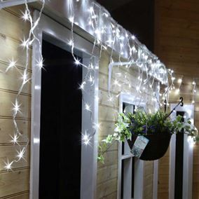 240 white led snowing icicle lights ukchristmasworld icicle white buy icicle lights at uk christmas world they come in different lengths colours including warm white multi coloured perfect for outdoor use aloadofball
