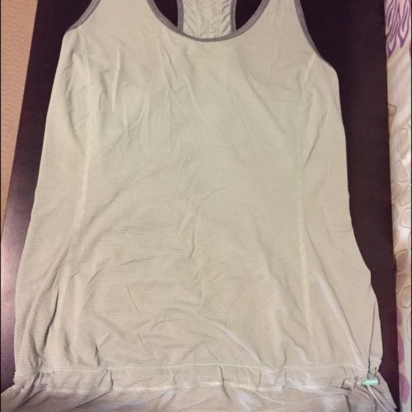 Lulu lemon racer back tank Used condition. Light Mint green and gray lulu tank. Drawstring near bottom hem. Side pocket. No tag, it was cut out. lululemon athletica Tops Tank Tops