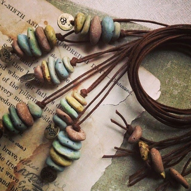 Photo of Lotus and Om stacked cairn beach stone necklaces. Handmade ceramic pebbles in ru…