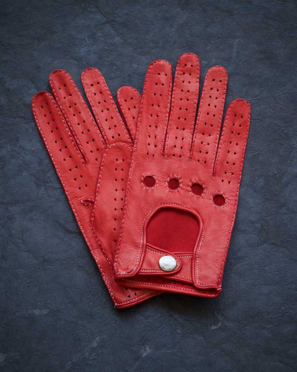 fd84cc5f4fbc9 Fratelli Orsini hand-sewn Italian leather driving gloves with contrast  stitching in bold red.