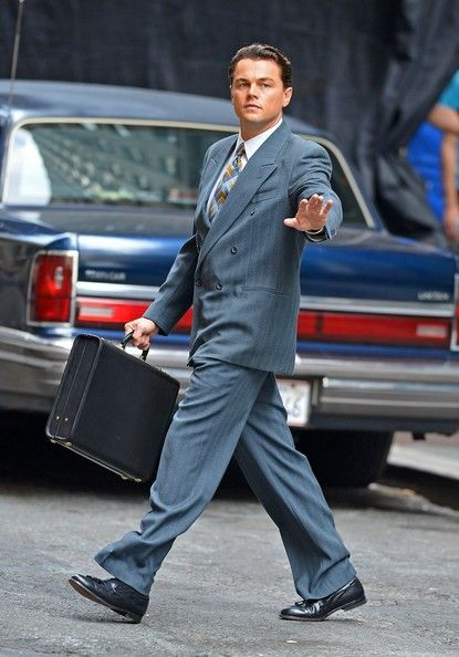 87ed17da542 Wearing a double-breasted blue suit and carrying a briefcase