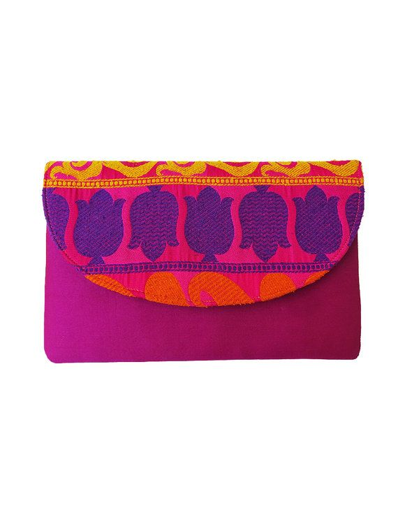 Buy Bright pink and colorful floral print embroidered clutch bag which is bohemian hippie with Indian fabrics